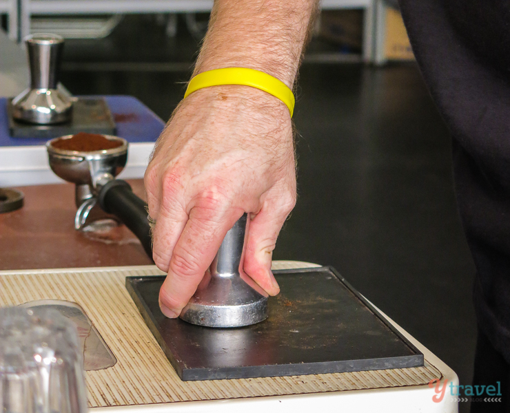 tamping coffee